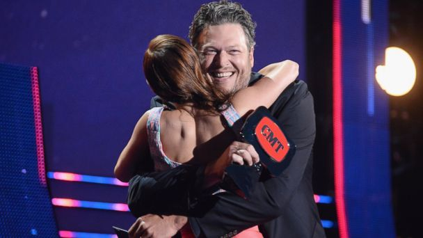 PHOTO: Cassadee Pope accepts an award onstage from Blake Shelton during the 2014 CMT Music awards at the Bridgestone Arena on June 4, 2014 in Nashville, Tenn.