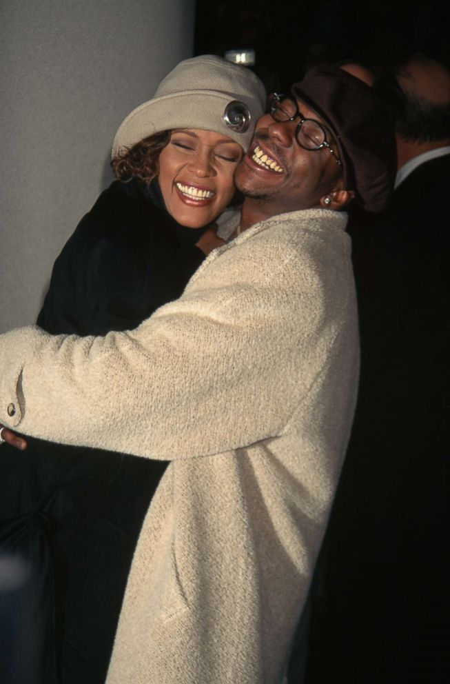 """Bobby Brown and Whitney Houston hug at the premiere of """"Cinderella"""" at Sony Lincoln Square Theater in New York, Oct. 27, 1997."""