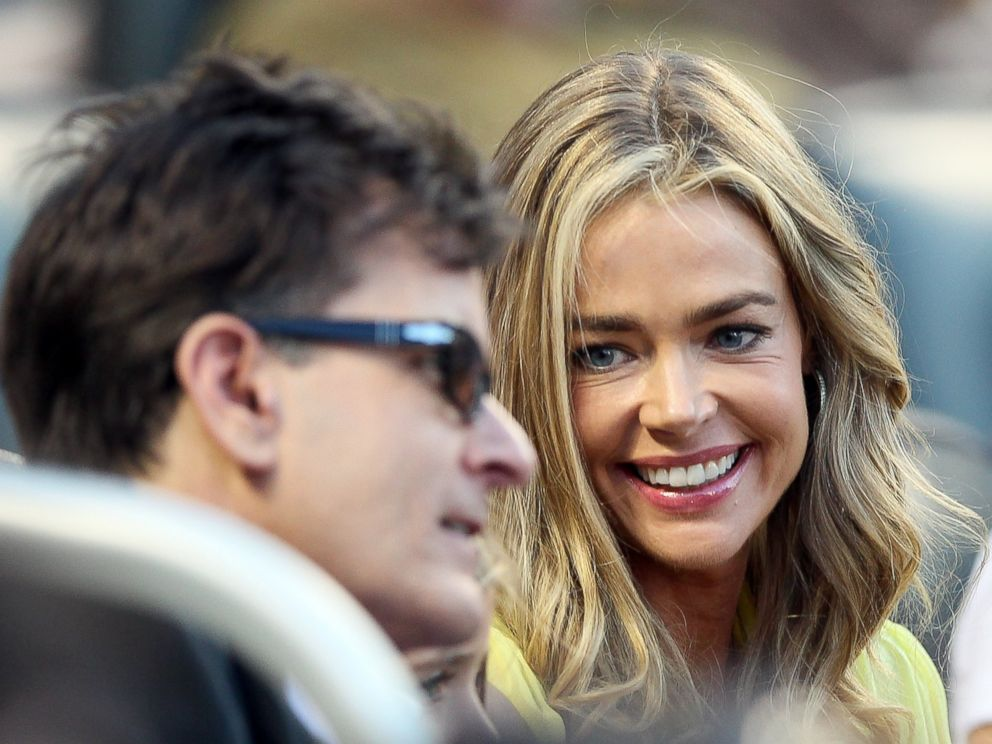PHOTO: Denise Richards and Charlie Sheen watch the New York Yankees take on the New York Mets on June 23, 2012 at Citi Field in New York.