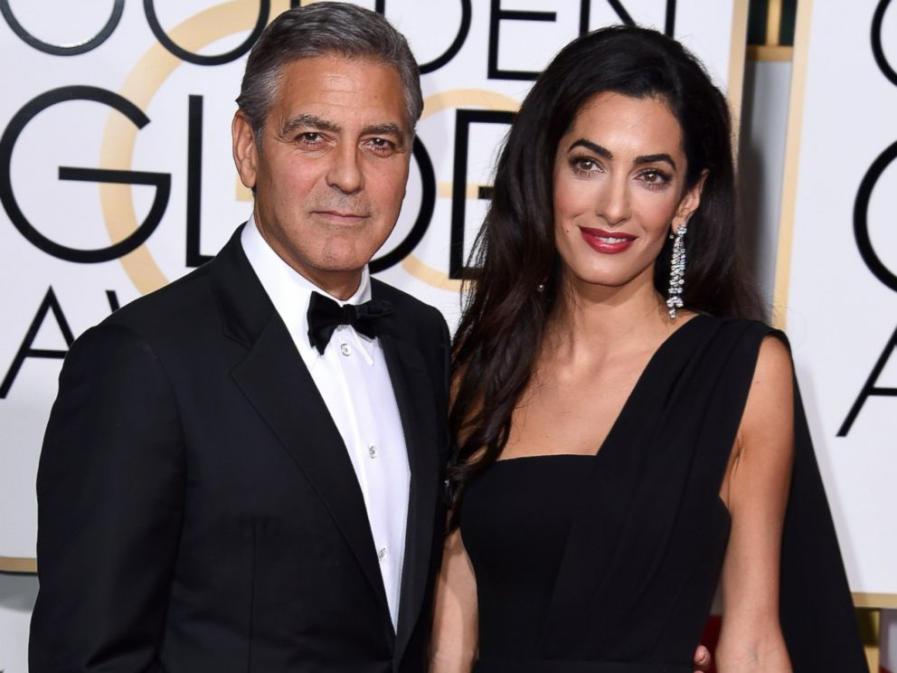 PHOTO: Actor George Clooney (L) and attorney Amal Alamuddin Clooney attend the Golden Globe Awards, Jan. 11, 2015 in Beverly Hills, California.