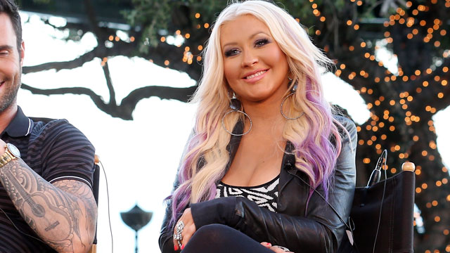 "PHOTO: The Voice's Christina Aguilera speaks onstage during the NBCUniversal's ""The Voice"" Press Junket on August 12, 2012 in Los Angeles."