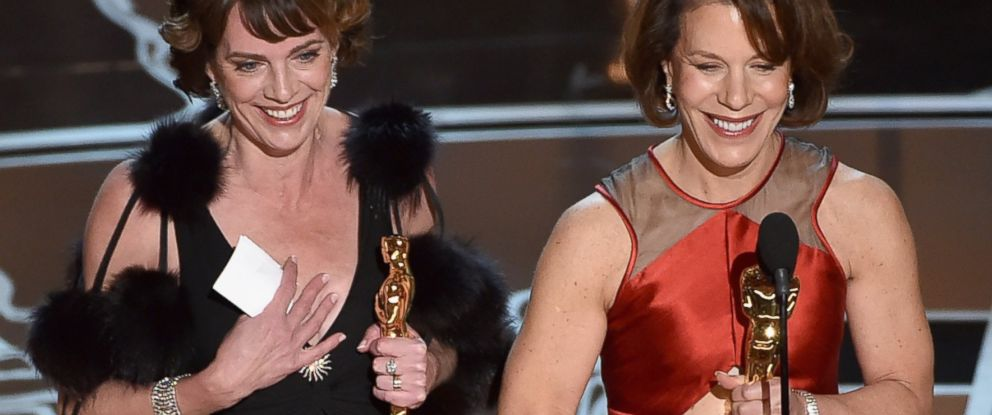 """PHOTO: Producer Dana Perry and director Ellen Goosenberg Kent accept the Best Documentary Short Award for """"Crisis Hotline; Veterans Press 1"""" onstage during the 87th Annual Academy Awards on Feb. 22, 2015 in Hollywood, California."""