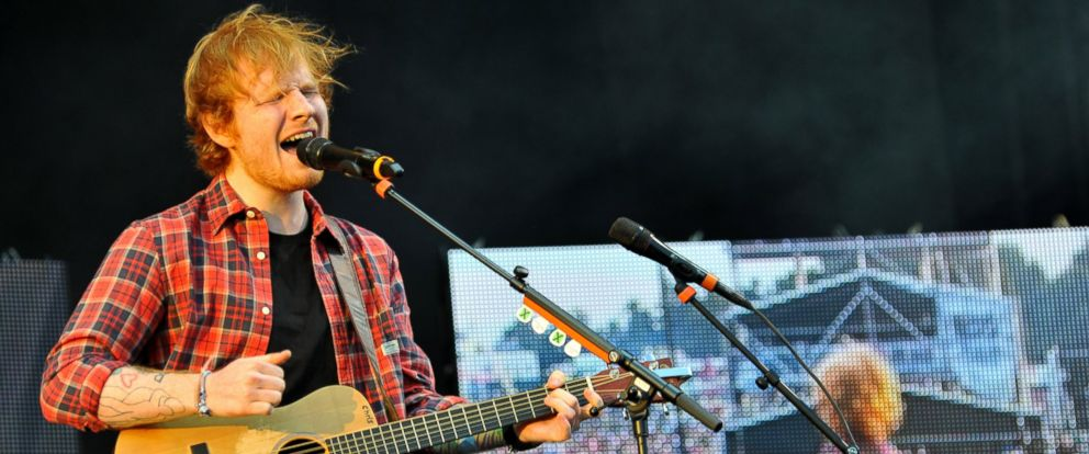 PHOTO: Ed Sheeran performs on stage at the V Festival at Hylands Park on Aug. 16, 2014 in Chelmsford, United Kingdom.