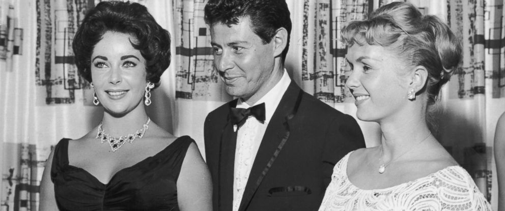 PHOTO: American singer Eddie Fisher stands with his wife, actress Debbie Reynolds, right, and actress Elizabeth Taylor, left, in Las Vegas, 1958.