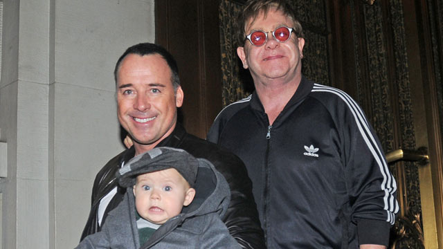 PHOTO: David Furnish and Elton John with their son Zachary leaving their hotel, October 27, 2011 in New York City.