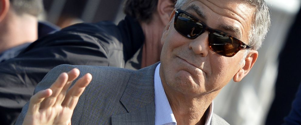 PHOTO: George Clooney waves from a taxiboat in Venice on Sept. 26, 2014 on the eve of his wedding.