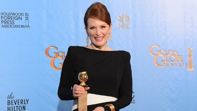 """PHOTO: Julianne Moore poses with her Best performance by an actress in a mini-series or motion picture made for television award for """"Game Change"""" in the press room at the Golden Globes awards ceremony in Beverly Hills, January 13, 2013."""