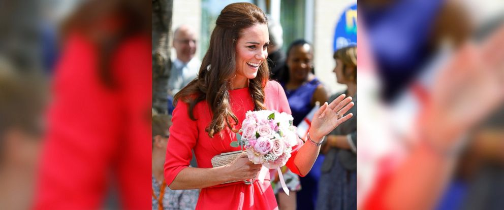 PHOTO: Catherine, Duchess of Cambridge waves as she visits an M-PACT Plus Counselling Programme at Blessed Sacrament School on July 1, 2014 in London, England.