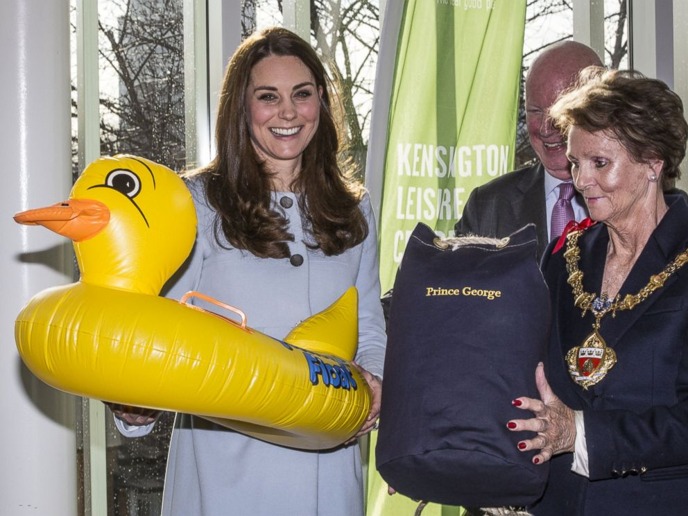 PHOTO: Catherine, Duchess of Cambridge is presented with an inflatable duck for Prince George during her tour of the new Kensington Leisure Centre on Jan. 19, 2015 in London, England.