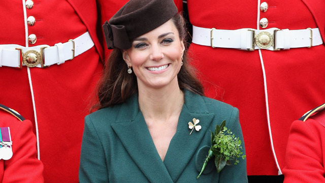 PHOTO: Catherine, the Duchess of Cambridge poses for an official photograph flanked by members of the Irish guards as she visits Aldershot Barracks on St Patricks Day in Aldershot on March 17, 2012.