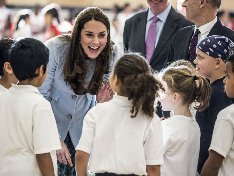 PHOTO: Catherine, Duchess of Cambridge talks to local school children after she arrived to open the new Kensington Leisure Centre on Jan. 19, 2015 in London, England.