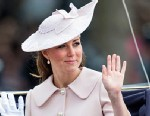 PHOTO: Catherine, Duchess of Cambridge, waves to the crowd during the annual Trooping The Colour ceremony at Horse Guards Parade on June 15, 2013 in London, England.