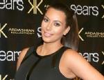 "PHOTO: Kim Kardashian poses on the red carpet at Sears to promote the ""Spring 2013 Kardashian Kollection"" on May 4, 2013 in Houston."