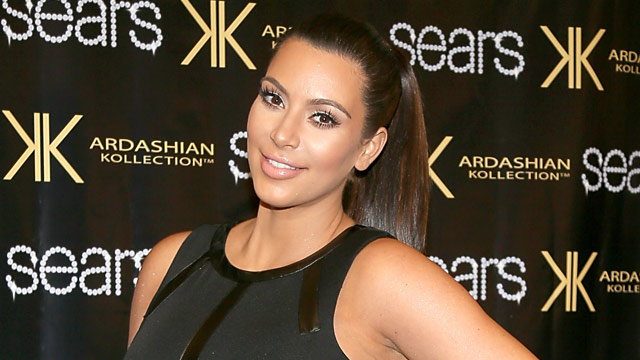 "PHOTO: Kim Kardashian poses on the red carpet at Sears to promote the ""Spring 2013 Kardashian Kollection"" on May 4, 2013 in Houston."