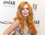 PHOTO: Actress Lindsay Lohan attends amfAR New York Gala To Kick Off Fall 2013 Fashion Week at 499 Seventh Avenue, Feb. 6, 2013 in New York.
