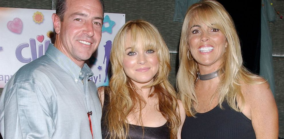 PHOTO: Lindsay Lohan with her father Michael Lohan and mother Dina Lohan are seen in this August 21, 2003 file photo.