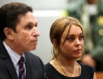 PHOTO: Troubled actress Lindsay Lohan appears in court for a pretrial hearing with her lawyer Mark Heller at the Airport Branch Courthouse of Los Angeles Superior Court, Jan. 30, 2013 in Los Angeles.