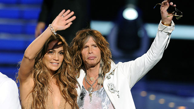 """PHOTO: Judges Jennifer Lopez and Steven Tyler walk onstage during Fox's """"American Idol 2011"""" finale results show."""