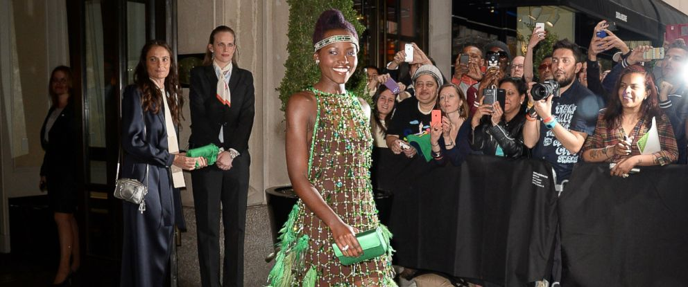 """PHOTO: Actress Lupita Nyongo is seen outside the """"Mark Hotel""""before attending the Met Gala on May 5, 2014 in New York City."""