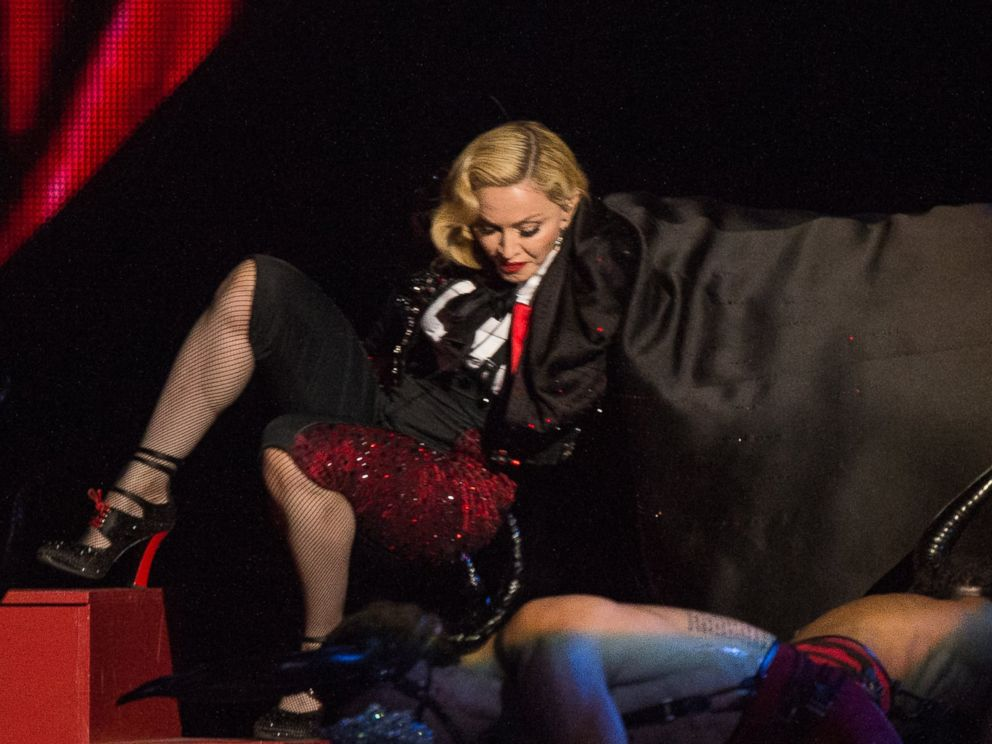 PHOTO: Madonna falls as she performs on stage for the BRIT Awards 2015 at The O2 Arena on Feb. 25, 2015 in London, England.