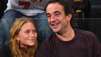 PHOTO: Mary-Kate Olsen and Olivier Sarkozy attend the Dallas Mavericks vs New York Knicks game at Madison Square Garden on Nov. 9, 2012 in New York City.