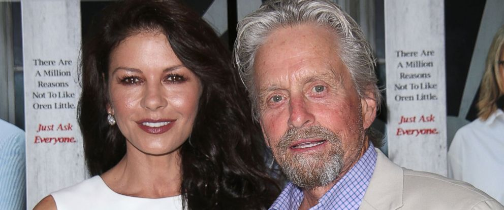 "PHOTO: Catherine Zeta Jones and Michael Douglas attend the ""And So It Goes"" premiere on July 6, 2014 in East Hampton, New York."