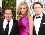 PHOTO: Actor Michael J. Fox, actress Tracy Pollan, and Mr. Golden Globe Sam Fox arrive at the 70th Annual Golden Globe Awards held at The Beverly Hilton Hotel, Jan. 13, 2013, in Beverly Hills.