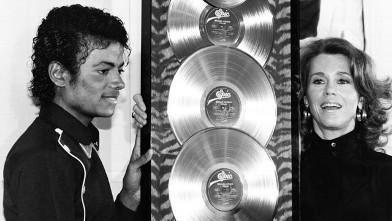 "PHOTO:Michael Jackson receives the first Triple Platimum awards for the multi-platinum 'Thriller,"" from Jane Fonda."
