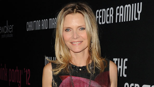 PHOTO: Actress Michelle Pfeiffer arrives at the 8th annual Elyse Walker Pink Party hosted by Michelle Pfeiffer to benefit Cedars-Sinai Women's Cancer Program held at HANGAR:8, Oct. 27, 2012, in Santa Monica, Calif.