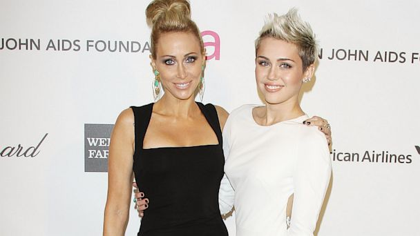 PHOTO: Tish Cyrus (L) and Miley Cyrus arrive at the 21st Annual Elton John AIDS Foundation Academy Awards viewing party held at West Hollywood Park on February 24, 2013 in West Hollywood, Calif.
