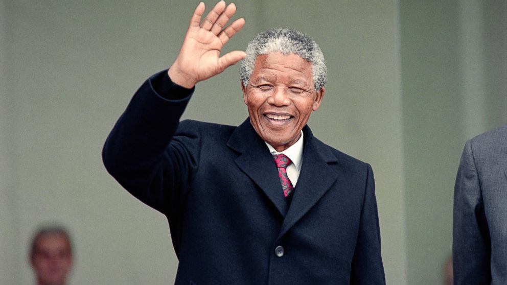 South African anti-apartheid leader Nelson Mandela waves to the press as he arrives at the Elysee Palace, June 7, 1990, in Paris, to have talks with French president Francois Mitterrand.