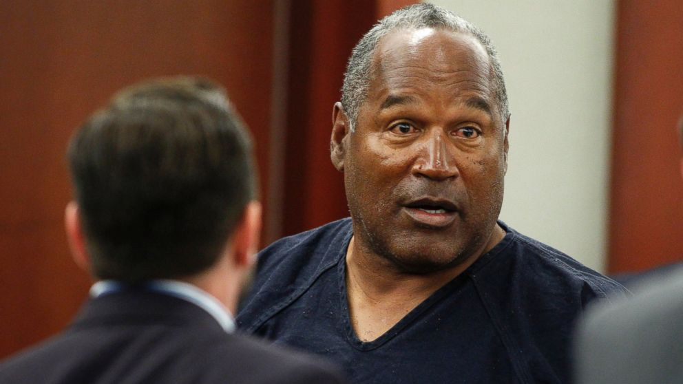 O.J. Simpson stands at the end of an evidentiary hearing in Clark County District Court on May 17, 2013 in Las Vegas.