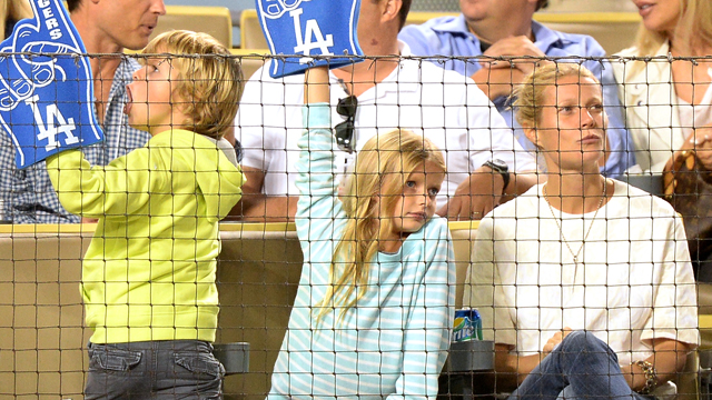 PHOTO:Actress Gwyneth Paltrow and her family watch the game between the Arizona Diamondbacks and the Los Angeles Dodgers at Dodger Stadium on Sept. 11, 2013 in Los Angeles.