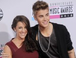 PHOTO: Singer Justin Bieber (R) and mom Pattie Mallette arrive at the 40th Anniversary American Music Awards at Nokia Theatre L.A. Live on Nov. 18, 2012 in Los Angeles, Calif.