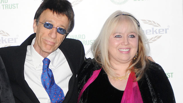 PHOTO: Robin Gibb and wife Dwina Gibb arrive at the Celebration of the Bee Gees evening in aid of The Outward Bound Trust at Battersea Evolution on Jan. 12, 2009 in London, England.