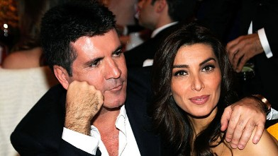 PHOTO: Simon Cowell and Mezhgan Hussainy attend the 18th Annual Elton John AIDS Foundation Academy Award Party at Pacific Design Center, March 7, 2010 in West Hollywood, Calif.
