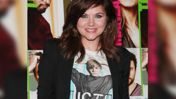 "PHOTO: Tiffani Thiessen wears a shirt with Justin Biebers picture to a screening of ""Horrible Bosses"" in New York City on June 23, 2011."