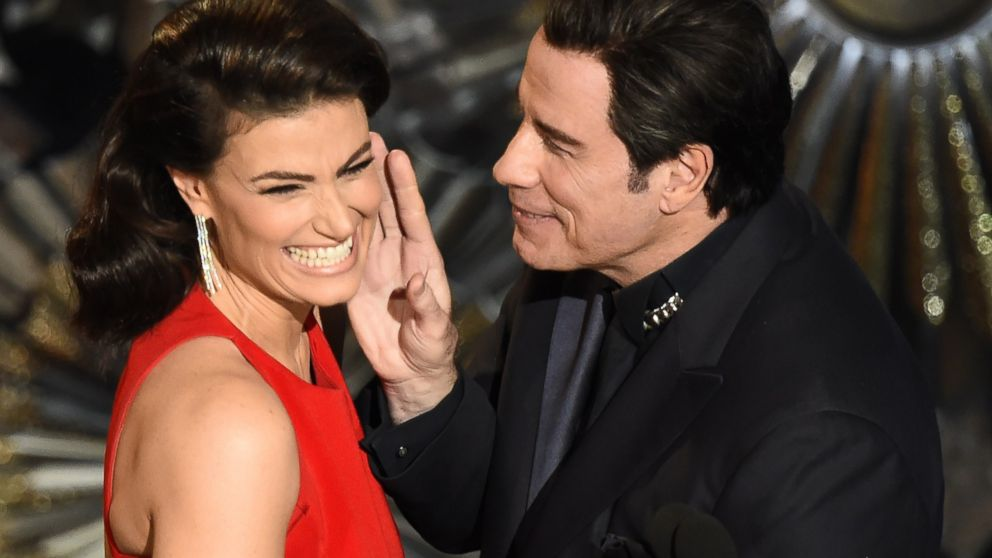 John Travolta (R) and Idina Menzel present an award on stage at the 87th Academy Awards, Feb. 22, 2015 in Hollywood, California.