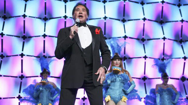 "PHOTO: Wayne Newton performs the theme song to ""Phineas and Ferb"" at Disneys presentation to licensees and retailers at the Licensing International Expo 2010 in Las Vegas."