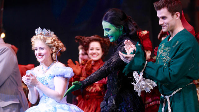 """PHOTO: From left, actors Alli Mauzey, Willemijn Verkaik and Kyle Dean Massey take a bow in """"Wicked"""" on Broadway at Gershwin Theatre, Feb. 12, 2013 in New York."""