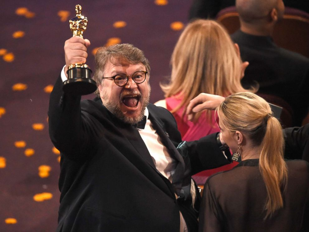 PHOTO: Guillermo del Toro, winner of the award for best director for The Shape of Water celebrates in the audience at the Oscars, March 4, 2018, at the Dolby Theatre in Los Angeles.