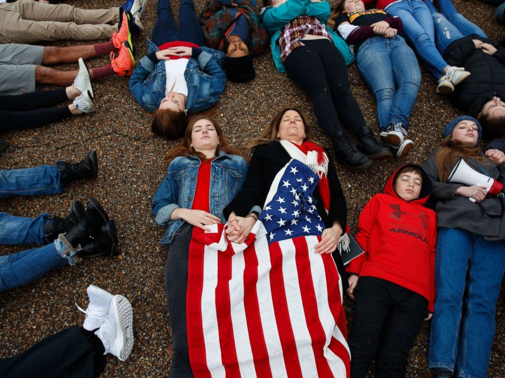 PHOTO: Abby Spangler and her daughter Eleanor Spangler Neuchterlein, 16, hold hands as they participate in a lie-in during a protest in favor of gun control reform in front of the White House, Feb. 19, 2018, in Washington.