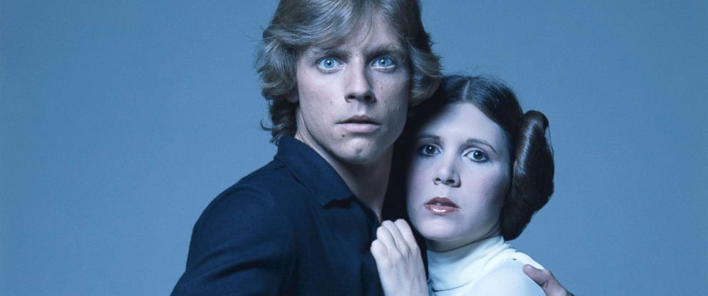 PHOTO: Mark Hamill and Carrie Fisher in costume as brother and sister Luke Skywalker and Princess Leia in George Lucas Star Wars trilogy, 1977.