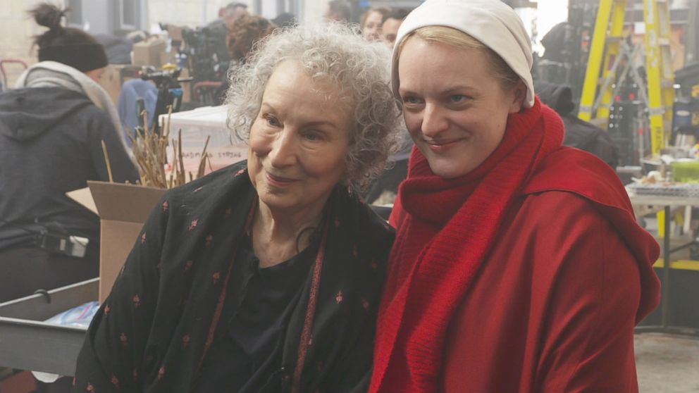 PHOTO: The Handmaids Tale author appears on the TV shows set with Elisabeth Moss.
