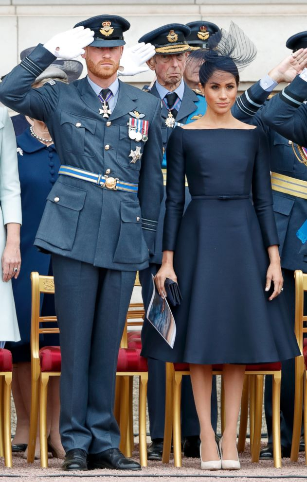 PHOTO: Prince Harry, Duke of Sussex and Meghan Markle, Duchess of Sussex attend a ceremony to mark the centenary of the Royal Air Force on the forecourt of Buckingham Palace, July 10, 2018 in London.