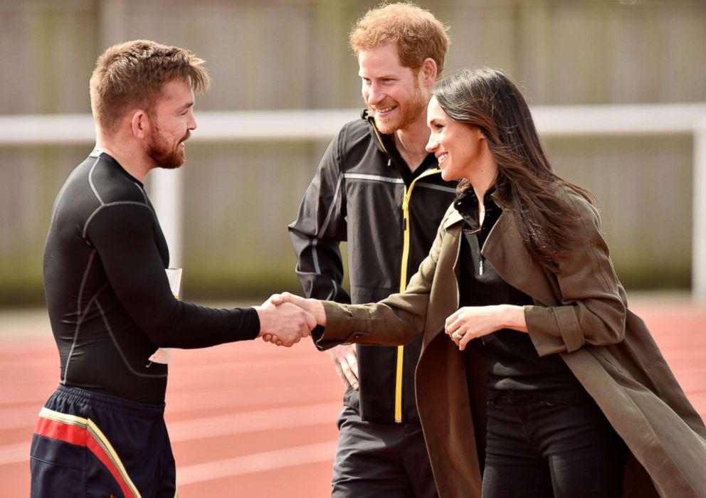 PHOTO: Britains Prince Harry and Meghan Markle greet an athlete as they visit Bath University, in Bath, England, April 6, 2018, to view hopeful candidates for the UK Team Trial for the Invictus Games in Sydney in 2018.