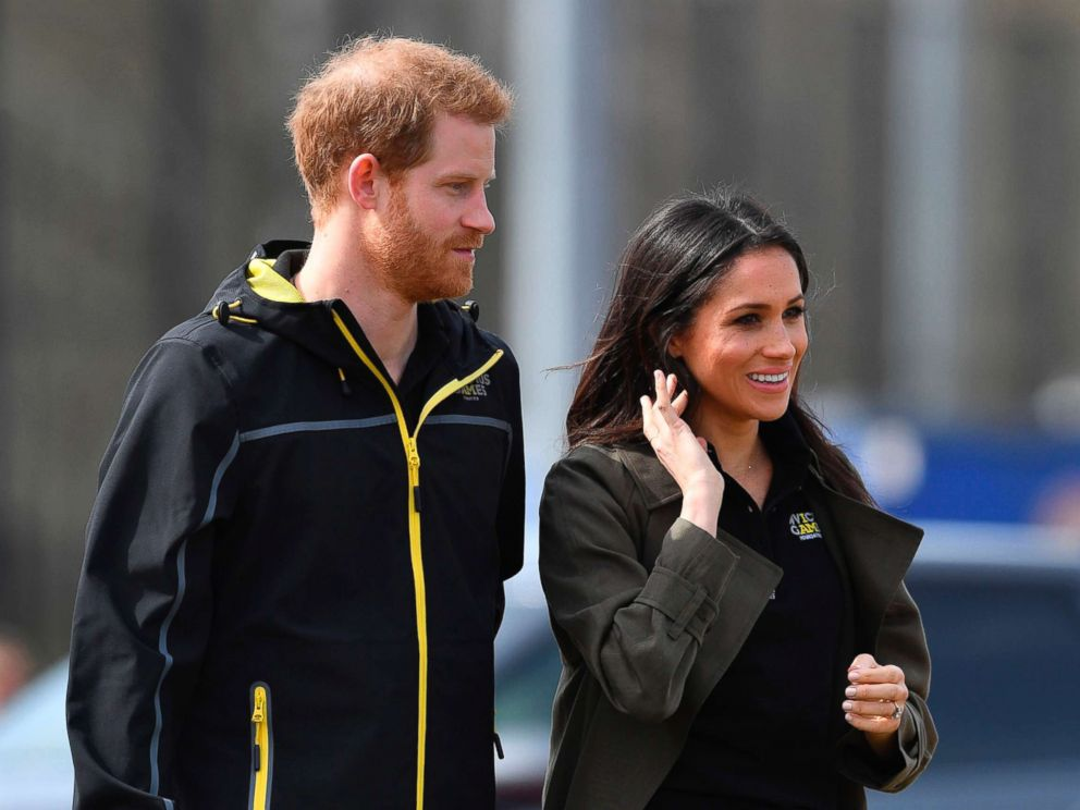 PHOTO: Britains Prince Harry and his fiancee actress Meghan Markle arrive to meet participants at the UK team trials for the Invictus Games Sydney 2018 at the University of Bath Sports Training Village in Bath, England, April 6, 2018.