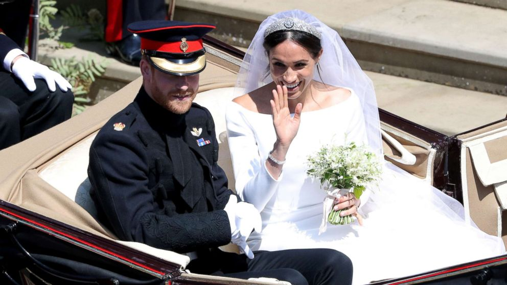 Prince Harry and Meghan Markle leave St George's Chapel in Windsor Castle after their wedding in Windsor, Britain, May 19, 2018.