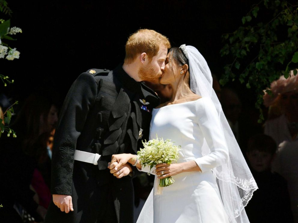 PHOTO: Prince Harry and Meghan Markle kiss on the steps of St Georges Chapel in Windsor Castle after their wedding, May 19, 2018.