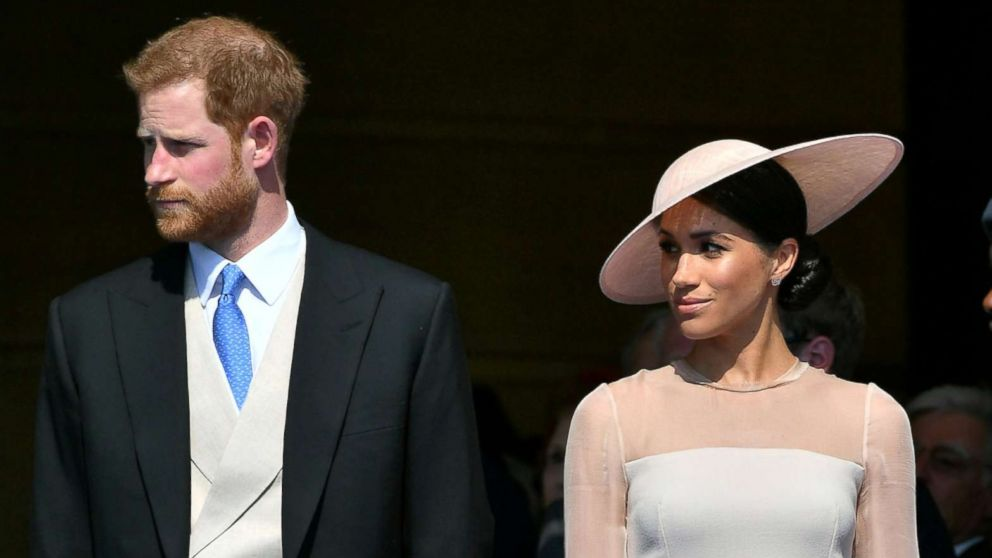 Britain's Prince Harry and Meghan, Duchess of Sussex attend a garden party at Buckingham Palace, their first royal engagement as a married couple, in London, May 22, 2018.